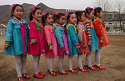 Carol Bellamy visits a kindergarten at Yonsan, where music and dancing are performed for her benefit. <br /> <br /> <br /> ©Jeremy Horner<br /> 15 Mar 2004
