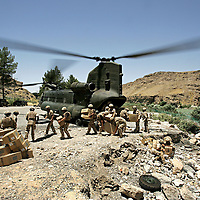 6th July 2007.Kajaki, Helmand Province, Afghanistan.A Chinook helicopter brings much needs supplies of food, spares and mail to the soldiers at a remote base in Kajaki, Helmand province, Afghanistan on the 6th of July 2007.