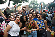 Group of friends on Sunday 28th August 2016 at the 50th Notting Hill Carnival in West London. A celebration of West Indian / Caribbean culture and Europes largest street party, festival and parade. Revellers come in their hundreds of thousands to have fun, dance, drink and let go in the brilliant atmosphere. It is led by members of the West Indian / Caribbean community, particularly the Trinidadian and Tobagonian British population, many of whom have lived in the area since the 1950s. The carnival has attracted up to 2 million people in the past and centres around a parade of floats, dancers and sound systems.