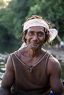 Portrait of a crewman of a small boat that carries copra from islands of Madang Province to the mainland of Papua New Guinea