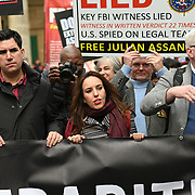 Richard Burgon, Stella Morris and Kristinn Hrafnsson at the front holding a big banners March for Assange freedom assembly at BBC march to Royal Court of Justice, 23 October 2021, London, UK.