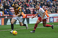 Ben Purkiss of Port Vale chased down by Sheffield United forward Che Adams  during the Sky Bet League 1 match between Sheffield Utd and Port Vale at Bramall Lane, Sheffield, England on 20 February 2016. Photo by Ian Lyall.