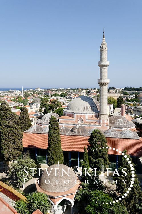 Rhodes. Greece. Elevated view of the dome and minaret of the pink Mosque of Suleiman (Suleyman) the Magnificent in the old town. Dating from 1522 the Mosque was built to honour the Sultans victory over the knights and has been partially rebuilt over the years.