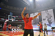Chicago Bulls' Derrick Rose reacts after sinking a shot during a comeback event for the team's star point guard sponsored by adidas at the United Center September 22, 2013 in Chicago, Illinois.  (For adidas)