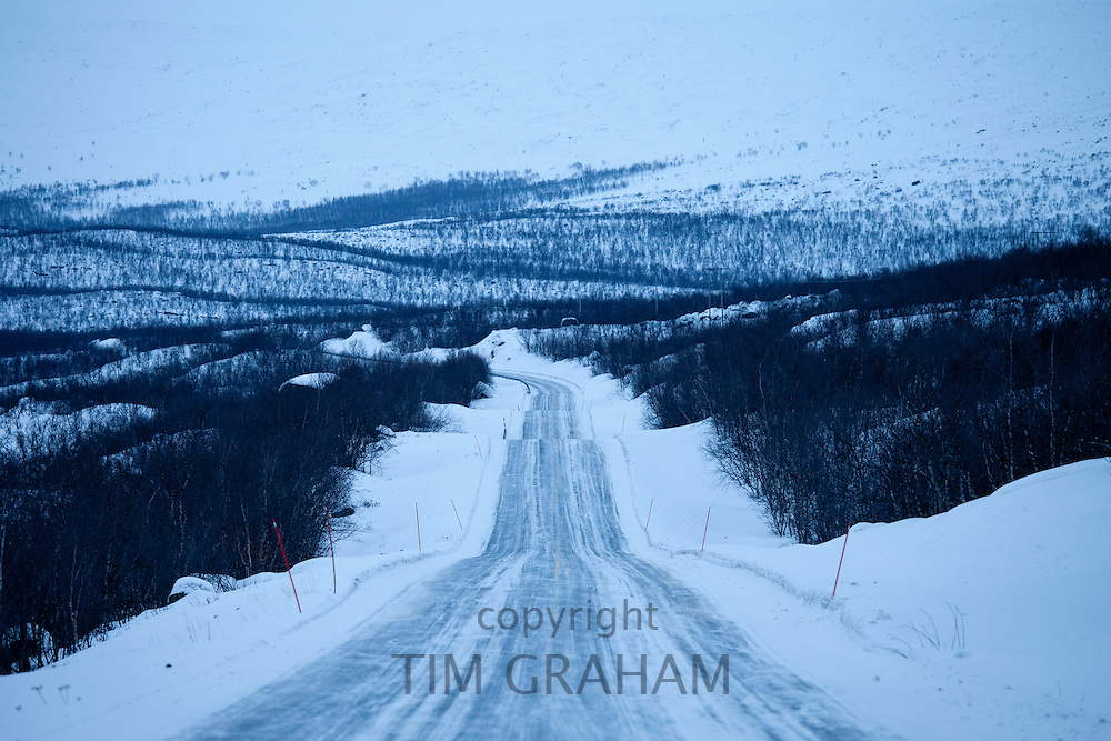 The route from Norway into Finland through arctic wilderness at nightfall by Kilpisjarvi, Finland