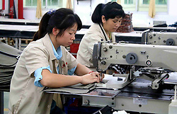 June 27, 2017 - Ji'An, Ji'an, China - Ji'an, CHINA-June 27 2017: (EDITORIAL USE ONLY. CHINA OUT) People work at a factory in east China. About 30,000 farmers become workers after receiving free training of professional skills in Ji'an, east China's Jiangxi Province, June 26th, 2017. (Credit Image: © SIPA Asia via ZUMA Wire)