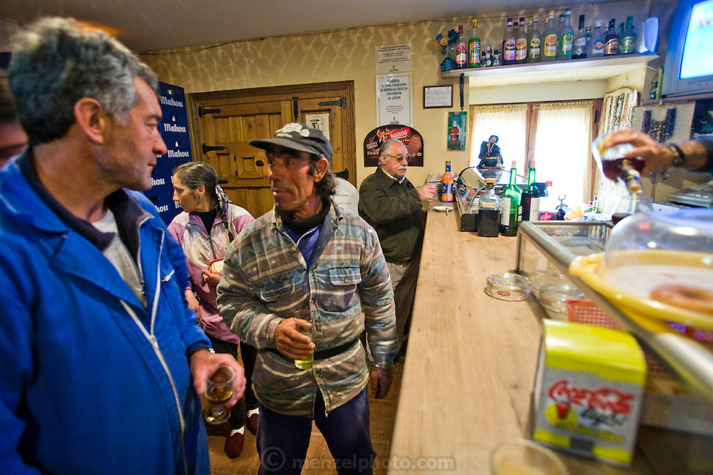 Shepherds Miguel Martinez, and his brother Paco stop at the village bar for two glasses of Muscatel after slaughtering a sheep for Easter at their farm in Zarzuela de Jadraque, Spain.   (Miguel Angel Martinez Cerrada  is featured in the book What I Eat: Around the World in 80 Diets.)