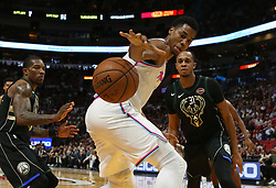 February 9, 2018 - Miami, FL, USA - The Miami Heat's Hassan Whiteside battles for a lose ball against the Milwaukee Bucks' Eric Bledsoe and John Henson (31) during the second quarter at the AmericanAirlines Arena in Miami on Friday, Feb. 9, 2018. The Heat won, 91-85. (Credit Image: © David Santiago/TNS via ZUMA Wire)