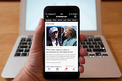 Using iPhone smartphone to display headlines from frontage of Washington Post online newspaper