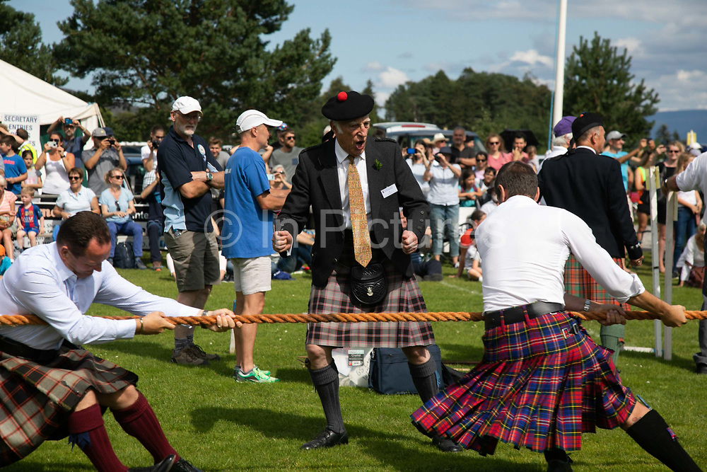 Highland Games, 3rd of August 2019, Newtonmore, Scotland, United Kingdom. Traditional tug owar. The Highland Games is a traditional annual event where competitors compete as strong men, runners, dancers, pipers and at tug-of-war. The games go back centuries and are happening through-out the summer across Scotland. The games are both an important event locally and a global tourist attraction.