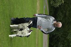 Eddie Sander with his Dogs Jackson and Inka<br /><br />18 June 2004<br /><br />Copyright Paul David Drabble<br /> [#Beginning of Shooting Data Section]<br />Nikon D1 <br /> Focal Length: 80mm<br /> Optimize Image: <br /> Color Mode: <br /> Noise Reduction: <br /> 2004/06/18 09:40:11.0<br /> Exposure Mode: Manual<br /> White Balance: Auto<br /> Tone Comp: Normal<br /> JPEG (8-bit) Fine<br /> Metering Mode: Center-Weighted<br /> AF Mode: AF-S<br /> Hue Adjustment: <br /> Image Size:  2000 x 1312<br /> 1/200 sec - F/7.1<br /> Flash Sync Mode: Not Attached<br /> Saturation: <br /> Color<br /> Exposure Comp.: 0 EV<br /> Sharpening: Normal<br /> Lens: 80-200mm F/2.8<br /> Sensitivity: ISO 200<br /> Image Comment: <br /> [#End of Shooting Data Section]