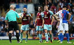 Burnley players react towards the referee before Phillip Bardsley is shown a yellow card - Mandatory by-line: Matt McNulty/JMP - 23/08/2017 - FOOTBALL - Ewood Park - Blackburn, England - Blackburn Rovers v Burnley - Carabao Cup - Second Round