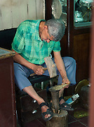 A metal worker in his workshop in the medina of Fes, Morocco