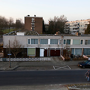 "Nederland Utrecht 31 januari 2009 20090131 Foto: David Rozing ..Serie vogelaarwijk Kanaleneiland .Reportage documentary on deprived area / projects "" Kanaleneiland "" This area is on a list with projects which need help of the government because of degradation in the area etc.2 jongens steken straat over in Kanaleiland Noord, overzicht wijk vanaf Prins Clausbrug churchillaan.2 boys passing the street .project, suburb, suburbian, problem. Neighboorhood, neighboorhoods, district, city, problems, multicultural,  daily life.Foto: David Rozing"