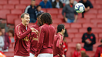 Football - 2018 / 2019 Premier League - Arsenal vs. West Ham United<br /> <br /> Stephan Lichtsteiner (Arsenal FC) and Mohamed Elneny (Arsenal FC) play rock paper scissors ahead of kick off at The Emirates.<br /> <br /> COLORSPORT/DANIEL BEARHAM