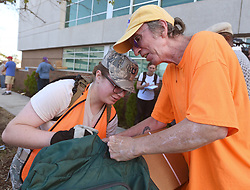 A volunteer tries to help Jack Thompson, 62 shove a box of MRE's into his backpack Tuesday, September 18, 2018 in Wilmington, N.C. New Hanover County, in partnership with FEMA, the Civil Air Patrol and volunteers from General Electric, gave out free water, tarps and the Meals Ready to Eat to county residents at three locations in Wilmington. Photo by Chuck Liddy/Raleigh News & Observer/TNS/ABACAPRESS.COM