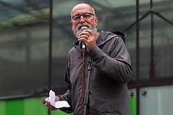 Jeremy Cox of Paid to Pollute addresses activists from Extinction Rebellion, Stop HS2 and XR Roads Rebellion outside the Department for Business, Energy and Industrial Strategy (BEIS) following the Stop The Harm march on the fourth day of Impossible Rebellion protests on 26th August 2021 in London, United Kingdom. Paid to Pollute are currently taking the Government to court regarding public payments to polluting North Sea oil and gas companies.