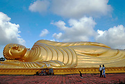 Songkhla.Wat Phr Norn Leam Poh, on Koh Yor, where a huge golden sleeping buddha dominates.A family from Malaysia come to visit, Songkhla.