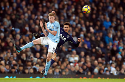 Tottenham Hotspur's Dele Alli (right) and Manchester City's Kevin De Bruyne battle for the ball during the Premier League match at the Etihad Stadium, Manchester.