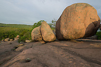 The Elephant Rocks are part of a small state park in Missouri. The area contains many large and round boulders made of granite. This was taken shortly after sunrise, when the early morning light gave the boulders a golden hue.<br />