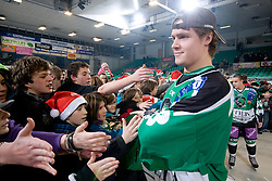Jure Kralj greets fans that are waiting for Christmas presents and meeting with players after ice-hockey match between HDD Tilia Olimpija and EC Red Bull Salzburg in 29th Round of EBEL league, on December 23, 2010 at Hala Tivoli, Ljubljana, Slovenia. (Photo By Matic Klansek Velej / Sportida.com)