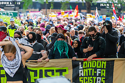 "Anti-fascist counter protesters march through the streets towards several hundred far right protesters in central London demanding the release of ""political prisoner"" right wing talisman Stephen Yaxley-Lennon  - also known as Tommy Robinson, who was imprisoned for contempt of court. London, August 03 2019."