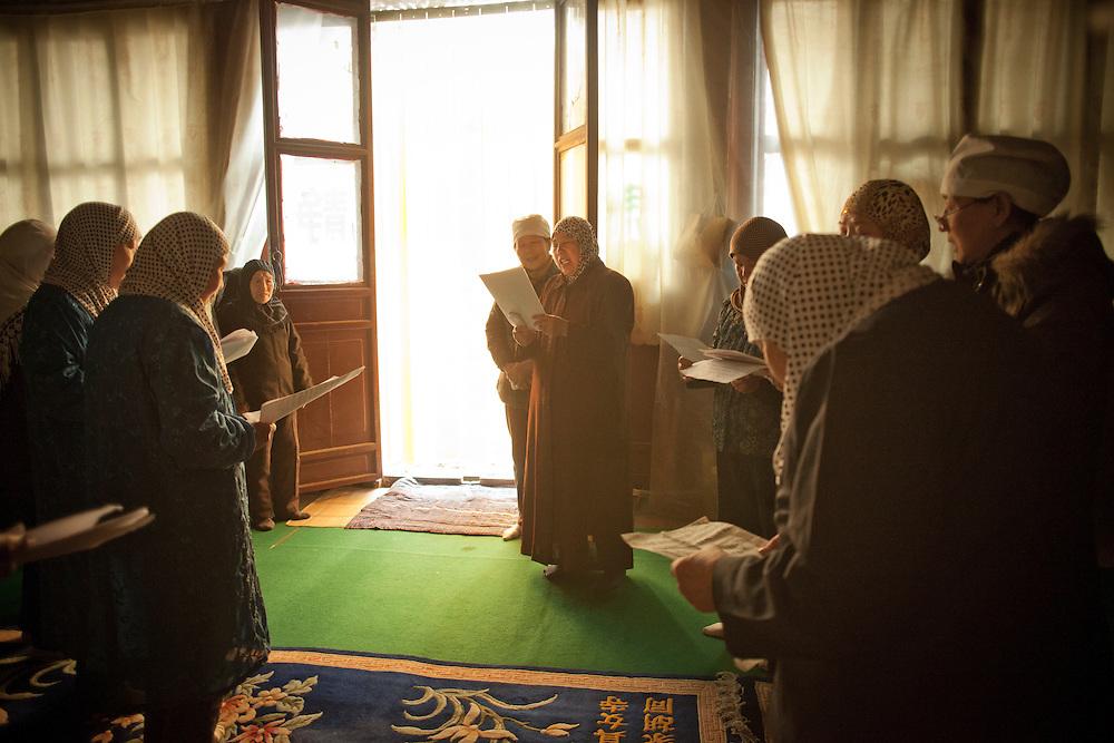 Women practice songs at the Wangjia Hutong Women's Mosque in Kaifeng, Henan province, China.