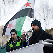 Dr. Omar Alhamdoon, President of Muslim Association of Britain (MAB) speaking at Anti-Assad Syrian demonstration held in Whitehall, Central London. The demonstration was called by the Syrian Community in the UK under the head lines; Syrians are being killed in a genocide and the world is watching. Several hundreds gathered opposite Downing Street 10 calling for Syrians to unite and the world to intervene.