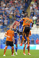 Cardiff City's Kenwyne Jones (9) beats Wolves' Ethan Ebanks-Landell (23) to a header. Skybet football league championship match, Cardiff city v Wolverhampton Wanderers at the Cardiff city stadium in Cardiff, South Wales on Saturday 22nd August 2015.<br /> pic by Carl Robertson, Andrew Orchard sports photography.