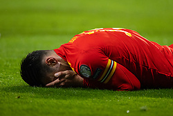 TALLINN, ESTONIA - Monday, October 11, 2021: Wales' Kieffer Moore holds his face after taking a knock during the FIFA World Cup Qatar 2022 Qualifying Group E match between Estonia and Wales at the A. Le Coq Arena. Wales won 1-0. (Pic by David Rawcliffe/Propaganda)