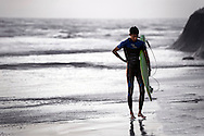 Surfer carrying surfboard coming out of the ocean at Terramar Beach in Carlsbad, CA.<br /> <br /> ALSO AVAILABLE AS SIGNED, LIMITED EDITION PRINT. SERIES LIMITED TO 10 THIS IMAGE ALSO AVAILABLE AS SIGNED, LIMITED EDITION PRINT. SERIES LIMITED TO 10. <br /> <br /> EMAIL RR@ROBERTRANDALL.COM FOR PRICING