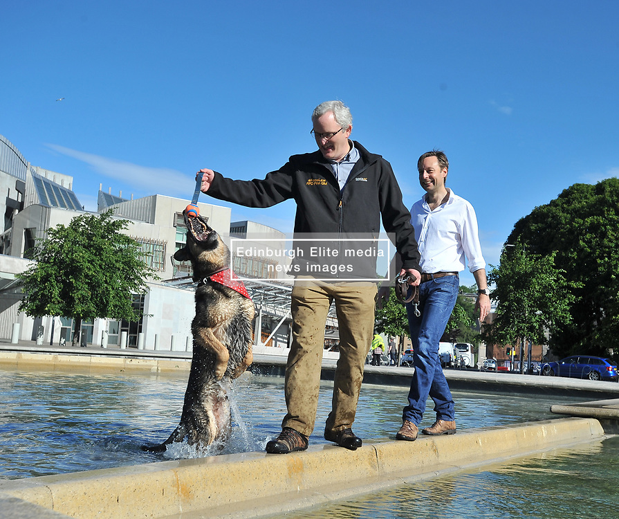 Pictured: Retired police dog Finn, with his owner and handler PC Dave Wardell and MSP Liam Kerr outside the Parliament.<br /> <br /> Police dog Finn, who was stabbed by an assailant while protecting his handler PC Dave Wardell, met with MSP Liam Kerr at the Scottish Parliament to discuss his ongoing campaign for a 'Finn's Law' to protect police and other service dogs.<br /> <br /> © Dave Johnston / EEm