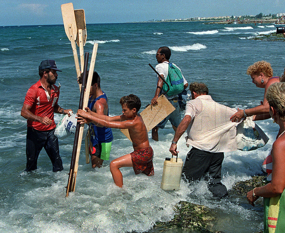 8/1994-Al Diaz/Miami Herald--The rafters traveled in large groups; neighbors, friends and families. In late August, Fidel Castro urged parents to consider the risk to children during the perilous crossing. He issued a directive to the Cuban coast guard and police: Do not let rafts and unsafe boats with children aboard leave the island.
