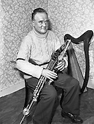 """Leo Rowsome.29/02/1959..Leo Rowsome (05/04/1903 – 20/09/1970) was the third generation of an unbroken line of uilleann pipers. He was performer, manufacturer and teacher of the uilleann pipes - the complete master of his instrument. He devoted his entire life to the uilleann pipes..Samuel Rowsome, Leo's grandfather sent his sons, John, Thomas and William to a German teacher of music who resided in Ferns, near their home in Co. Wexford to learn the theory of music and how to play various instruments. This knowledge was passed on through William to his son, Leo who made good use of it in his teaching, writing music for his many pupils..Leo was born in Harold's Cross, Dublin in 1903. His father, William realised that his son had the ability to become a talented musician and craftsman. Constantly watching his father making and repairing instruments, Leo learned the art of pipe making and instrument repair. So rapid was his progress at piping that in 1919 at the age of sixteen he was appointed teacher of the uilleann pipes at Dublin's Municipal School of Music (now D.I.T. Conservatory of Music & Drama) for 50 years. He also taught at Dublin's Pipers Club of which he was President..Leo was the first uilleann piper to perform on Irish National Radio in the early 1920s when he played solo and later in duets with Frank O'Higgins (fiddle), Micheal O Duinn (fiddle) and Leo's brother John (fiddle). Leo's """"All Ireland Trio"""" comprised Neilus Cronin, flute, Seamus O'Mahony, fiddle and Leo pipes. He formed his Pipes Quartet in the mid 1930s and broadcast regularly throughout the 1940s/50s. Leo was the first Irish artist to perform on BBC T.V. (1933). He made many recordings for Decca, Columbia and HMV. His last commercial recording, CC1 """"Ri na bPiobairi"""" (King of the Pipers) was made for Claddagh Records in 1966."""