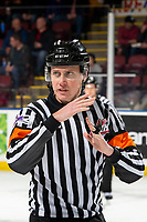 KELOWNA, BC - MARCH 11: Referee Ward Pateman stands on the ice and calls a time out at the Kelowna Rockets against the Victoria Royals at Prospera Place on March 11, 2020 in Kelowna, Canada. (Photo by Marissa Baecker/Shoot the Breeze)