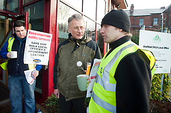 PCS members and supporters in Sheffield stage an eight-hour demonstration to protest  against the planned closure of the local office of the Driver and Vehicle Licensing Agency (DVLA). The protest was called to coincide with a visit to the premises by transport minister Mike Penning.on Monday (23 January) but according to Mike Mackie, assistant secretary of the PCS northern branch for the DVLA, the visit was canceled within 15 minutes of the Sheffield Demo being announced on the PCS website..Mike Mackie and Mark Devlin talk to Alistair Tice of the Sheffield Socialist Party who came along to show support..www.pauldaviddrabble.co.uk..23 January 2012 -  Image © Paul David Drabble