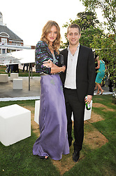 TYRONE WOOD and ROSIE HUNTINGTON-WHITELEY at the annual Serpentine Gallery Summer Party sponsored by Canvas TV  the new global arts TV network, held at the Serpentine Gallery, Kensington Gardens, London on 9th July 2009.
