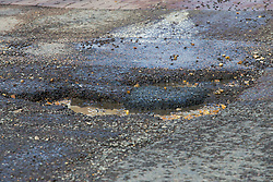 The recent cold, wet weather has given rise to the increase in potholes and road surface deterioration as shown here on Brondesbury Road in West London's Queens Park. London, March 28 2018.