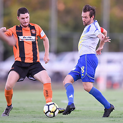 BRISBANE, AUSTRALIA - JANUARY 8: Michael Angus of Strikers and Scott Fulton of Easts compete for the ball during the Kappa Silver Boot Group A match between Brisbane Strikers and Eastern Suburbs on January 8, 2017 in Brisbane, Australia. (Photo by Patrick Kearney)