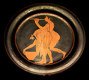Plate signed by Epikleitos as painter. Epikleitos was a pupil of the first painters to use the red figure technique, invented in Athens in about 530 BC. He decorated numerous cups and several plates. His clarity of line and the deliecacy of the two revellers enable us to recognise even his unsigned works. Made in Athens about 520-500BC