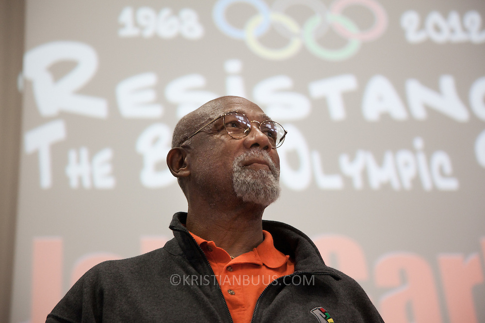 Resistance: The best Olympic Spirit. With John Carlos, Doreen Lawrence, Janet Alder and others. John Carlos on stage talking about his lifelong experience with political struggle and the personal costs he has had to pay. John Carlos won Bronze in the 200 Olympics final in 1968 in Mexico. He and his fellow black American runner, Tommie Smith who won Gold, raised their black gloved fists, wearing no shoes, on the podium to highlight the plight of black Americans. Both lost their medals and were expelled from the American Olympic team and sent home where they faced years of death threats and struggling to keep their careers going. The image of the two men became an iconic symbol of standing up against oppression not just for black Americans but worldwide.