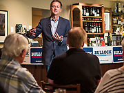 10 JULY 2019 - MARSHALLTOWN, IOWA: Governor STEVE BULLOCK (D-MT) talks to voters during a campaign stop at a cafe in Marshalltown Wednesday. Gov. Bullock is in a crowded field of Democrats vying to be the party's Presidential nominee in 2020. Iowa traditionally hosts the the first election event of the presidential election cycle. The Iowa Caucuses will be on Feb. 3, 2020.     PHOTO BY JACK KURTZ