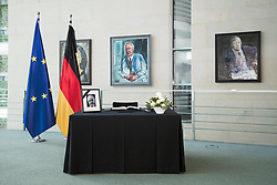 June 18, 2017 - Berlin, Germany - A table with a portrait of Helmut Kohl and a nook of condolence are pictured at the Chancellery in Berlin, Germany on June 18, 2017. Former Chancellor Helmut Kohl has died at the age of 87 years in Ludwigshafen am Rhein-Oggersheim, Germany on 16 June, 2017. (Credit Image: © Emmanuele Contini/NurPhoto via ZUMA Press)