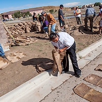 091413       Cable Hoover<br /> <br /> Volunteers sort and fill sand bags in an effort to control flood waters at Navajo Technical University in Crownpoint Saturday.