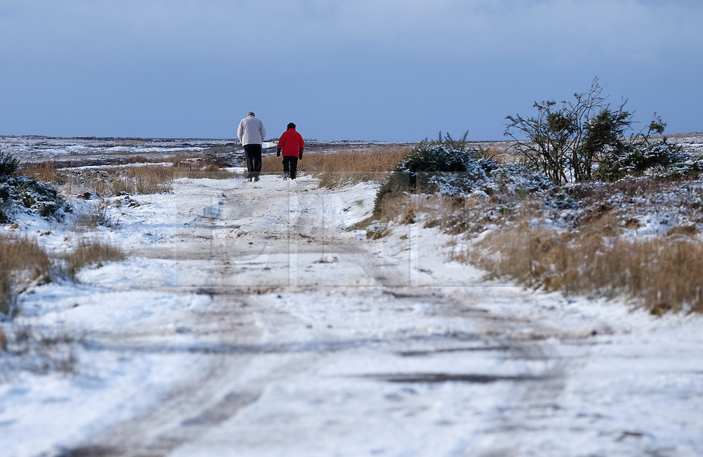 © Licensed to London News Pictures. <br /> 29/01/2015. <br /> <br /> Danby, United Kingdom<br /> <br /> A couple go for a walk along a snow covered track near Danby in North Yorkshire following overnight snow. A wintery blast causing extremely cold weather is expected to cause some disruption over the next few days.<br /> <br /> Photo credit : Ian Forsyth/LNP
