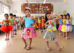 June 5, 2017 - Shijiazhuang, Shijiazhuang, China - Shijiazhuang, CHINA-June 5 2017: (EDITORIAL USE ONLY. CHINA OUT) Kids present creative clothes made of recycled materials including newspaper and plastics at an eco-friendly fashion show in Shijiazhuang, north China's Hebei Province, June 5th, 2017, marking World Environment Day. (Credit Image: © SIPA Asia via ZUMA Wire)