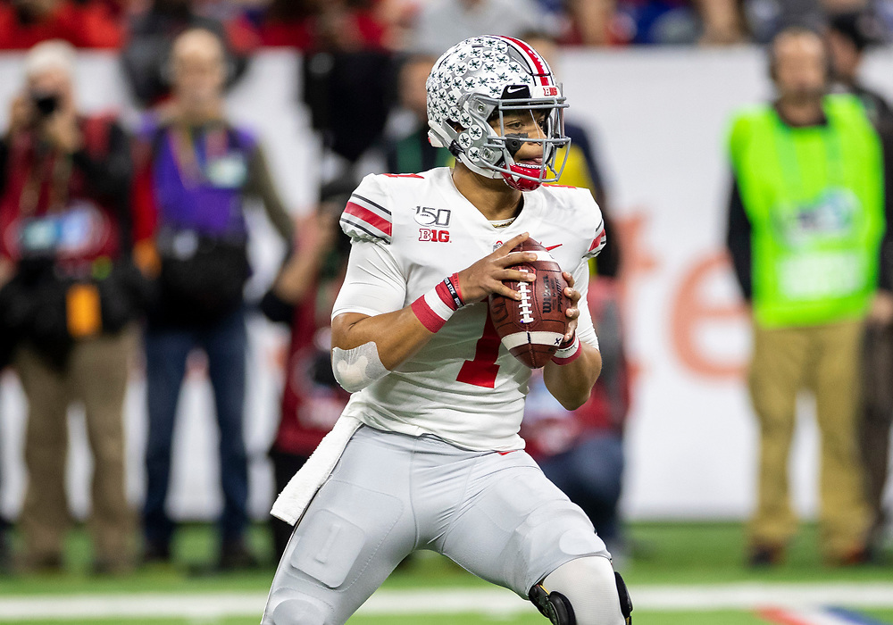 December 07, 2019:  Ohio State quarterback Justin Fields (1) passes the ball during NCAA Football game action between the Ohio State Buckeyes and the Wisconsin Badgers  at Lucas Oil Stadium in Indianapolis, Indiana.  Ohio State defeated Wisconsin 34-21.  John Mersits/CSM