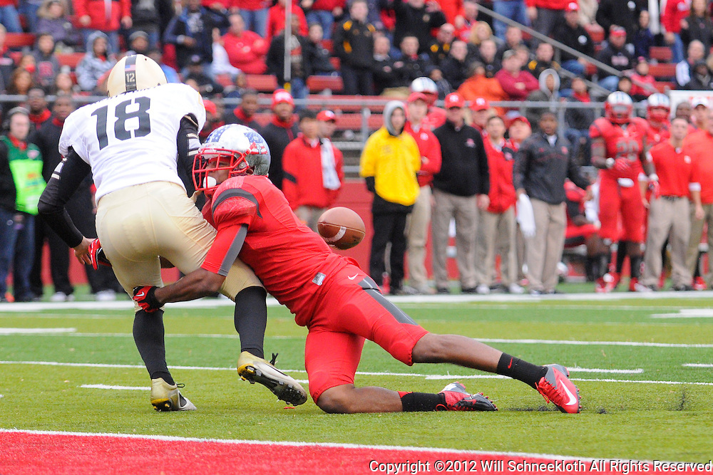 10 November 2012: Rutgers Scarlet Knights wide receiver Quaron Pratt (7) knocks the ball away from Army Black Knights punter Chris Boldt (18) after the punt was blocked during NCAA college football action between the Rutgers Scarlet Knights and Army Black Knights at High Point Solutions Stadium in Piscataway, N.J.. Rutgers defeated Army 28-7.