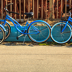 St. Michaels, MD, USA - March 30, 2013: Blue bicycles parked near an outside restaurant in St. Michaels, Maryland.