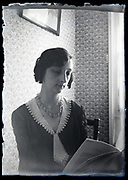 adult woman reading indoors circa 1930s